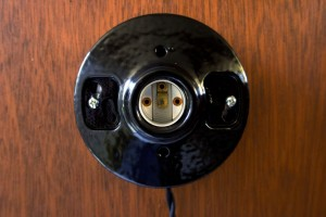 ceramic socket attached to metal plate
