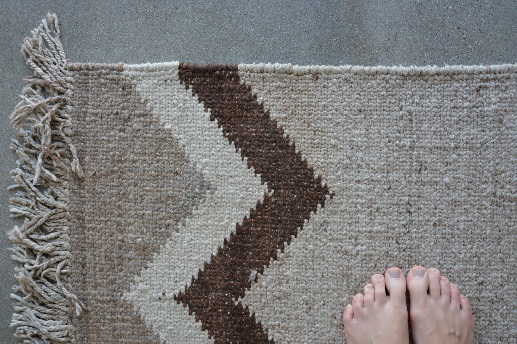 beige rug and feet