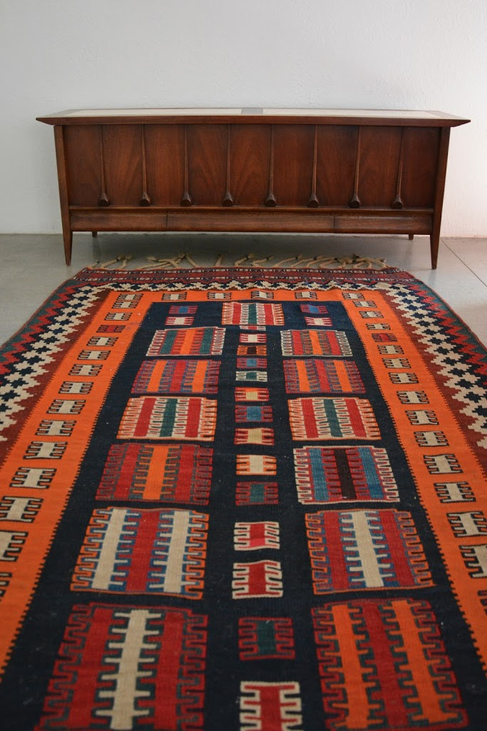 teak chest and kilim rug